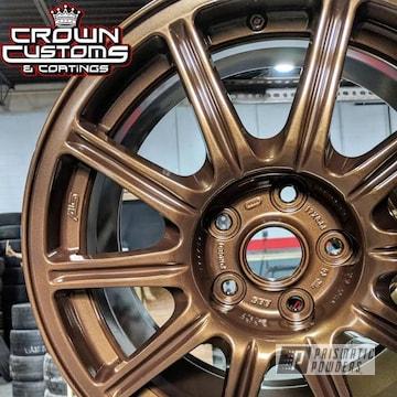Subaru Sti Wheels Refinished In Golden Brown