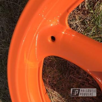 Custom Motorcycle Wheels In Alien Silver And Striker Orange