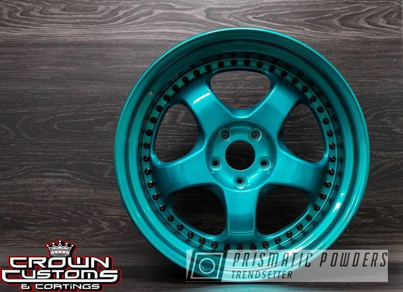 Custom 2 Piece Wheels refinished in Super Chrome base &  Jamaican Teal top coat with the Barrels in Gloss Black