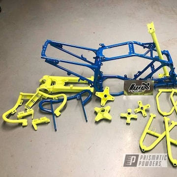 Atv Parts And Frame In A Honda Yellow And Sparks Blue Powder Coat