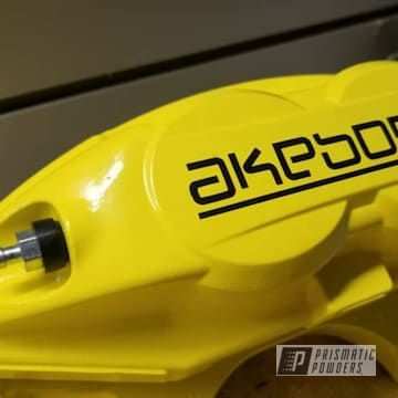 Glowing Yellow, Powder Coated Akebono Calipers Going On A 2017 Maxima With Bigger Rotors