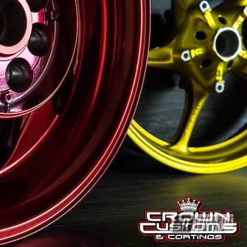 Powder Coated Motorcycle Wheels In A Red And Gold Finish