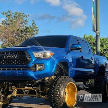 Lifted Toyota Tacoma Truck In Transparent Gold