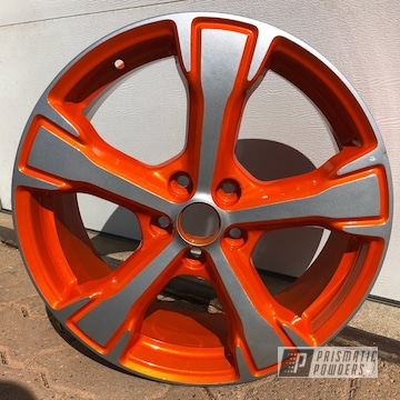16 Inch Alloy Wheels In A Orange And Silver Powder Coat