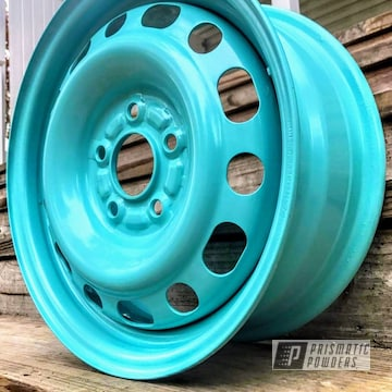 Powder Coated 15 Inch Civic Rims In A Teal Color